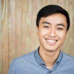 closeup portrait smiling handsome asian man 1262 3728